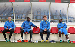 Sutton United players sit in the dug out during the training session at Gander Green Lane, London.
