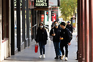 A group pf people are seen wearing facemasks on Lygon Street during COVID-19. A further 238 Coronavirus cases have been discovered overnight, bringing Victoria's active cases to over 2000, speculation is rising that almost all of Victoria's current cases stem from the Andrews Government botched hotel quarantine scheme as well as the Black Lives Matter protest.  Premier Daniel Andrews warns that Victoria may go to Stage 4 lockdown if these high numbers continue. (Photo be Dave Hewison/ Speed Media)