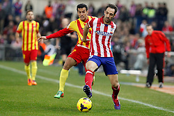 11.01.2014, Estadio Vicente Calderon, Madrid, ESP, Primera Division, Atletico Madrid vs FC Barcelona, 19. Runde, im Bild Atletico de Madrid´s Juanfran (R) and Barcelona´s Pedro Rodriguez // Atletico de Madrid´s Juanfran (R) and Barcelona´s Pedro Rodriguez during the Spanish Primera Division 19th round match between Club Atletico de Madrid and Barcelona FC at the Estadio Vicente Calderon in Madrid, Spain on 2014/01/11. EXPA Pictures © 2014, PhotoCredit: EXPA/ Alterphotos/ Victor Blanco<br /> <br /> *****ATTENTION - OUT of ESP, SUI*****