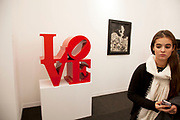 LOVE by Robert Indiana. Visitors and exhibitors at the many galleries exhibiting at the Frieze Art Fair 2012. This art fair is for work at the high end of international contemporary art with many well known artists on show from many of the world's most reknowned dealers.