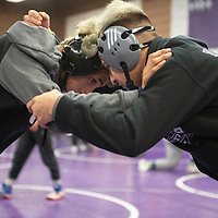 Sean Matthew Garcia, left, district champion, and Drake Guerrero, right, returning state champion prep for the upcoming New Mexico Athletic Association state wrestling tournament Tuesday afternoon at Miyamura High School. Miyamura High School is sending 12 boys and 7 girls to compete at the New Mexico Athletic Association state wrestling tournament this weekend at the Santa Ana Star Center in Rio Rancho.