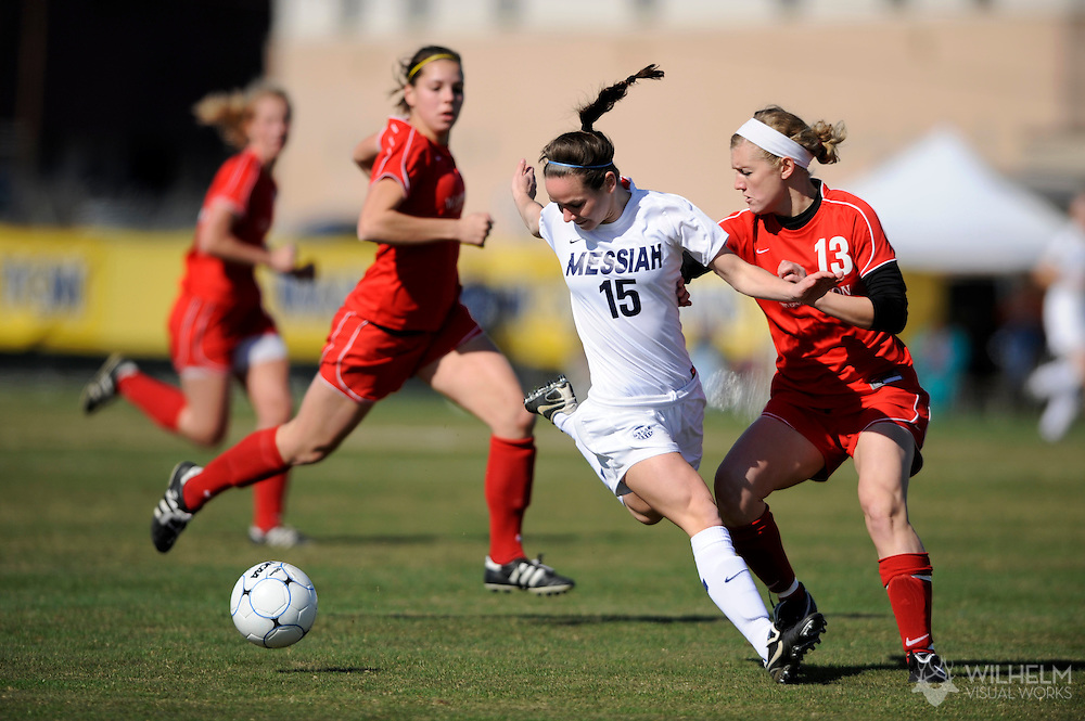 05 DEC 2009:  Corrine Wulf (15) of Messiah College is stopped by Sam Murphy (13) of Washington University in St. Louis during the Division III Women's Soccer Championship held at Blossom Soccer Stadium hosted by Trinity University in San Antonio, TX.  Messiah defeated Washington 1-0 for the national title.  © Brett Wilhelm