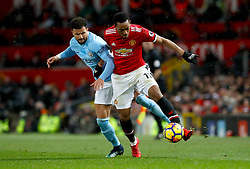 Manchester City's Kyle Walker (left) and Manchester United's Anthony Martial battle for the ball during the Premier League match at Old Trafford, Manchester.