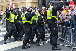 "Police push back against far right protesters as they surge towards anti-fascist counter protesters as several hundred far right demonstrators in central London demand the release of ""political prisoner"" right wing talisman Stephen Yaxley-Lennon  - also known as Tommy Robinson, who was imprisoned for contempt of court. London, August 03 2019."