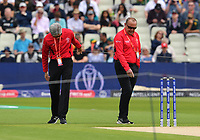 Cricket - 2019 ICC Cricket World Cup - Group Stage: New Zealand vs. South Africa<br /> <br /> Umpires Nigel Llong (left) and Ian Gould out in the middle for the inspection, at Edgbaston, Birmingham.<br /> <br /> COLORSPORT/ASHLEY WESTERN