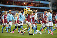 Aston Villa Mascot and the players walk out to the pitch. The FA cup, 6th round match, Aston Villa v West Bromwich Albion at Villa Park in Birmingham, Midlands on Saturday 7th March 2015<br /> pic by John Patrick Fletcher, Andrew Orchard sports photography.