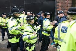 © Licensed to London News Pictures . 07/04/2018. Manchester, UK. Police move to contain a group of fans running through streets and chanting Manchester City slogans in Manchester's Northern Quarter , ahead of the Manchester City vs Manchester United derby match. If they win the match, Manchester City will win the League title. Photo credit : Joel Goodman/LNP