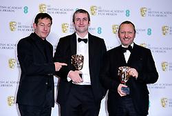 Jason Isaacs presents Jonathan Hodgson and Richard Van Den Boom with their Best British Short Animation Bafta for Roughhouse in the press room at the 72nd British Academy Film Awards held at the Royal Albert Hall, Kensington Gore, Kensington, London.