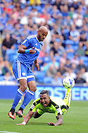 Cardiff City's Frederic Gounongbe (l) fouls Reading's Liam Moore. EFL Skybet championship match, Cardiff city v Reading at the Cardiff city stadium in Cardiff, South Wales on Saturday 27th August 2016.<br /> pic by Carl Robertson, Andrew Orchard sports photography.