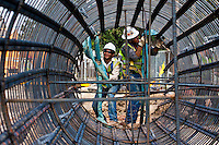 Construction workers work on the continuation of the red line on the north line station, an extension of 5.28 miles in Houston