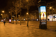 """March, 19th, 2020 - Paris, Ile-de-France, France: Pinocchio advert on empty Avenue des Champs Elysees in Paris, on the third day of a near total lockdown imposed in France. All journeys outside the home unless justified for essential professional or health reasons are outlawed. Anyone flouting the new regulations is punished with monetary fines. French police control of citizens and inspection of valid papers allowing citizens to travel. The most extreme measures so far in France to control the spread of the Coronavirus. Earlier in the week, President of France, Emmanuel Macron, said that citizens must stay at home from midday on Tuesday for at least 15 days. He said """"We are at war, a public health war, certainly but we are at war, against an invisible and elusive enemy"""". Nigel Dickinson"""