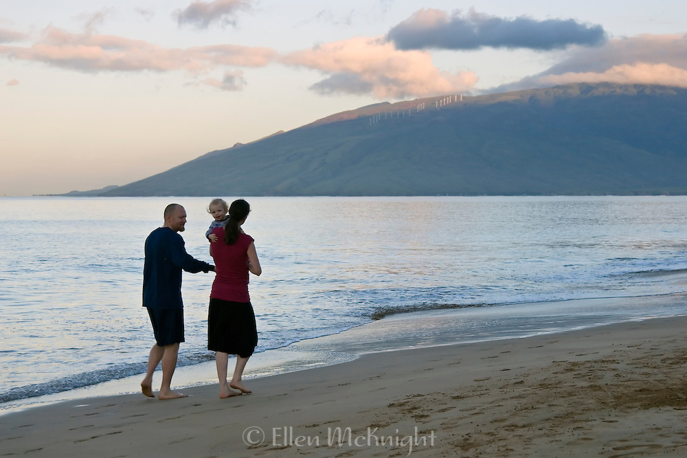 Mother, Father and Baby Walking on the Beach at Sunrise in Maui, Hawaii