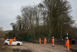 Wendover, UK. 20th February, 2021. HS2 security workers guard an area of woodland alongside Small Dean Lane which is currently being cleared for the HS2 high-speed rail link. Anti-HS2 activists continue to occupy the Wendover Active Resistance Camp on the opposite side of the rail line from the woodland.