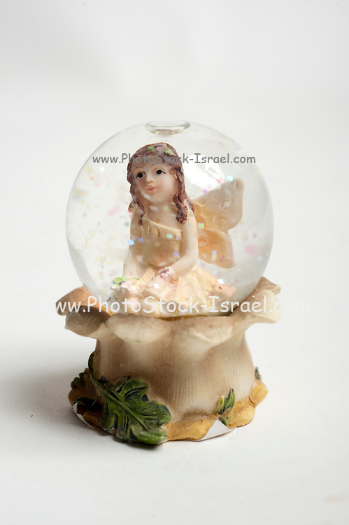 Cutout of a Fairy snow storm ornament on white background