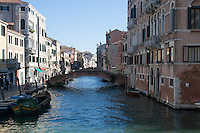 view of channel with bridge and historical buildings in Venice, Italy