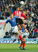 Photograph: Scott Heavey.<br />Southampton v Portsmouth. FA Barclaycard Premiership. 21/12/2003.<br />Claus Lundekvam beats everyone in the air
