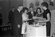 "17/12/1962<br /> 12/17/1962<br /> 17 December 1962<br /> A.E.I. Gala reception at Shangri-la Hotel, Dalkey, Dublin, where a Gala Supermatic washing machine was presented to the Variety Club of Ireland for their Easter Draw by Gala. At the function were Des O'Keefe, Chief Barker, Variety Club of Ireland; Patricia Kavanagh, (Gala Demonstrator); Mr. P.N. Walsh, Area Manager for Ireland; Aine Twomey, (Gala Demonstrator) and Annette Vahey, (Gala Demonstrator) drawing the tickets for the lucky winners in the Gala ""Take your chance"" promotion for purchasers of Gala products."