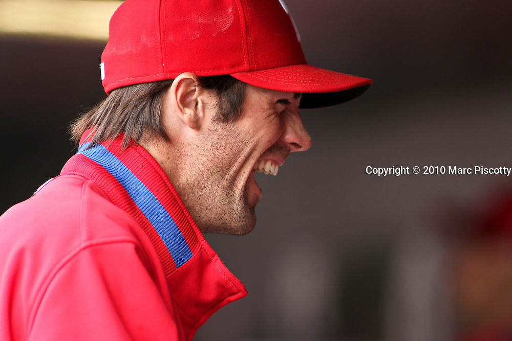 SHOT 5/12/10 2:23:48 PM - Philadelphia Phillies' pitcher Cole Hamels laughs in the duggout as he watches his teammates play against the Colorado Rockies during their regular season game at Coors Field in Denver, Co. The Rockies won the game 4-3 on a walk off home run in the 10th inning. (Photo by Marc Piscotty / © 2010)