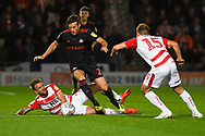 Adam Matthews of Sunderland (2) evades a challenge from James Coppinger of Doncaster Rovers (26) during the EFL Sky Bet League 1 match between Doncaster Rovers and Sunderland at the Keepmoat Stadium, Doncaster, England on 23 October 2018.