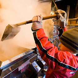 Jacob Perkins tends the sap evaporator at the Fifield's Sugarhouse in Strafford, Vermont.