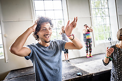 """13 August 2016, Norrbyskär, Umeå, Sweden: Marcel Mukdad enjoys dancing during a workshop on Zumba fitness, held by Maria Zaitunah at the Kul-Tur Fest (""""Culture Festival""""). Marcel is from Syria, but now lives in Ålidhem in Umeå, Sweden. He is currently pursuing a master's in public health studies at Umeå University. He is also a musician, and plays """"oud"""", a string instrument which he describes as an Arabic Lute. The Kul-Tur Fest, which attracted hundreds of people, set out to offer a meeting place for Swedish culture and new forms of cultural expression, and featured baking competitions, dance workshops, book discussions, fingernail painting and music, among other things."""