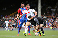 Crystal Palace goalkeeper, Julian Speroni (1) saving from Fulham striker, Matt Smith (09)  during the Pre-Season Friendly match between Fulham and Crystal Palace at Craven Cottage, London, England on 30 July 2016. Photo by Matthew Redman.
