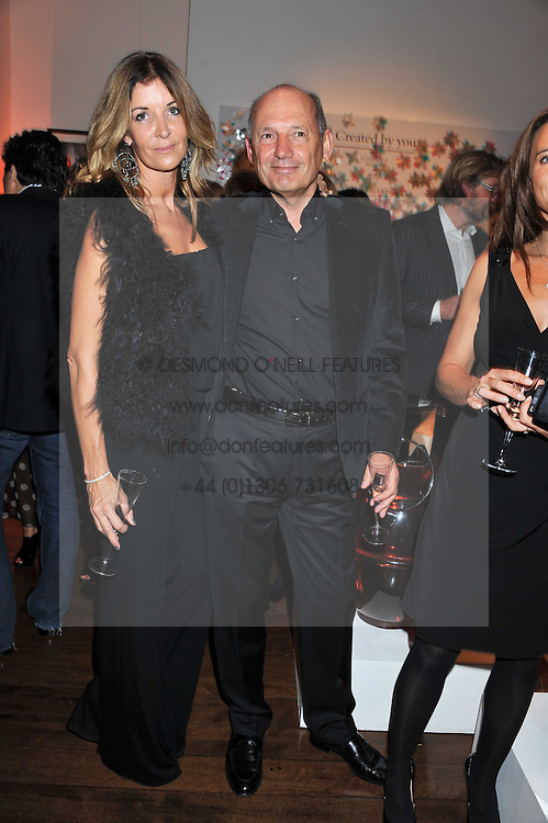 CAROL WEATHERALL and RON DENNIS at a reception to celebrate the publication of Candy and Candy: The Art of Design held at the Halcyon Gallery, 24 Bruton Street, London W1 on 26th October 2011.
