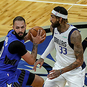 ORLANDO, FL - MARCH 01: Evan Fournier #10 of the Orlando Magic pulls the ball back from Willie Cauley-Stein #33 of the Dallas Mavericks during the first half at Amway Center on March 1, 2021 in Orlando, Florida. NOTE TO USER: User expressly acknowledges and agrees that, by downloading and or using this photograph, User is consenting to the terms and conditions of the Getty Images License Agreement. (Photo by Alex Menendez/Getty Images)*** Local Caption *** Evan Fournier; Willie Cauley-Stein