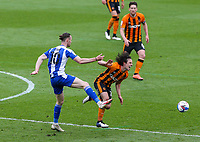 Hull City's George Honeyman is fouled by Wigan Athletic's Will Keane<br /> <br /> Photographer Alex Dodd/CameraSport<br /> <br /> The EFL Sky Bet League One - Hull City v Wigan Athletic - Saturday 1st May 2021 - KCOM Stadium - Kingston upon Hull<br /> <br /> World Copyright © 2021 CameraSport. All rights reserved. 43 Linden Ave. Countesthorpe. Leicester. England. LE8 5PG - Tel: +44 (0) 116 277 4147 - admin@camerasport.com - www.camerasport.com