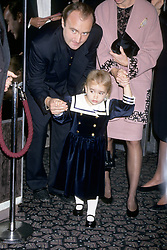 English musician Phil Collins pictured with his daughter Lily Collins, aged 3.