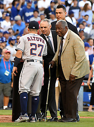 October 25, 2017 - Los Angeles, California, U.S. - Hall of Famer Hank Aaron, right, awards the Hank Aaron Award to Houston Astros' Jose Altuve (27) and Florida Marlins Giancarlo Stanton as Major League Baseball commissioner Rob Manfred looks on prior to game two of a World Series baseball game between the Houston Astros and the Los Angeles Dodgers at Dodger Stadium on Wednesday, Oct. 25, 2017 in Los Angeles. (Photo by Keith Birmingham, Pasadena Star-News/SCNG) (Credit Image: © San Gabriel Valley Tribune via ZUMA Wire)