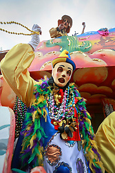 02 March 2014. New Orleans, Louisiana.<br /> Mardi Gras. Float riders, members of the Krewe of Thoth dispense beads and trinkets at the  parade in Uptown New Orleans.<br /> Photo; Charlie Varley/varleypix.com