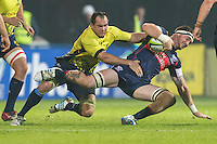Daniel Carpo (L) of Romania tries to stop John Cullen (R) of USA during their  rugby test match between Romania and USA, on National Stadium Arc de Triomphe in Bucharest, November 8, 2014.  Romania lose the match against USA, final score 17-27.