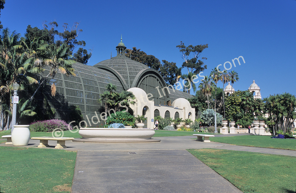 """Reflecting pool in foreground. The Botanical Building is the largest wood lath structure in the world.<br /> <br /> Balboa Park, located near downtown San Diego, is a historic architetural jewel featuring museums, an arts village, gardens, restaurants, hiking trails, The Old Globe theatre complex and the world famous San Diego Zoo. <br /> <br /> By the 1890's, under the auspices of Kate Sessions, """"The Mother of Balboa Park,"""" the park transformed from a unmanaged space of land into a lush landscape of popular plants including bird of paradise, queen palms and poinsettias. <br /> <br /> The 1915-16 Panama-California Exposition held in Balboa Park marked the opening of the Panama Canal and sparked the design of the Park as it appears today. Most of the arts organizations along Balboa Park's famous El Prado pedestrian walkway are housed in Spanish-Renaissance style buildings constructed for the 1915 Exposition. <br /> <br /> It introduced the beautiful ornamental architectural style to the United States."""