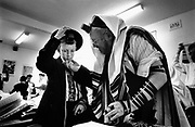 Mordechai Slavin's grandfather from Israel whisphers a few words of encouragement before his grandsons Barmitzvah in Bondi's Yeshiva Centre Sydney.