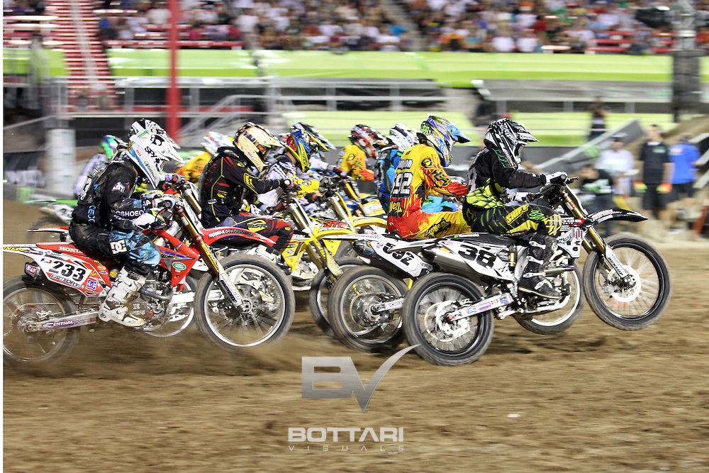 LAS VEGAS, NV - OCTOBER 15: Chris Blose, driver of the #38 Dodge Motorsports Kawasaki 450, leads the pack out of the gates during Maine Event 1 of the inaugural Monster Energy Cup on October 15, 2011 in Las Vegas, Nevada.  (Photo by Jeff Bottari/Getty Images)
