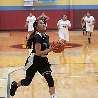 Tianalee Jim (14) drives to the basket for Tse' Yi' Gai in their game against Rehoboth Tuesday night.