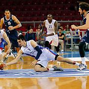 Anadolu Efes's Dario Saric (C) during their Turkish Basketball League Play Off round 3 match Anadolu Efes between Turk Telekom at Abdi Ipekci Arena in Istanbul Turkey on Tuesday 26 May 2015. Photo by Aykut AKICI/TURKPIX