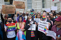 London, UK. 23rd June, 2021. Jayne Ozanne of the Ban Conversion Therapy Coalition addresses campaigners against LGBT+ conversion therapy at a picket outside the Cabinet Office and Government Equalities Office. They also handed in a petition signed by 7,500 people calling on the government to fulfil its 2018 promise to ban LGBT+ conversion therapy.