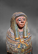 Ancient Egyptian Cartonnage funerary mask from the Third Intermediate Period, 22nd Dynasty (944-1025BC).  Egyptian Museum, Turin. Grey background<br /> <br /> Made from overlapping papyrus and cloth this cartonnage has been decorated with a weskh collar over which are depicted two crossed cloth strips that represent the last bandages of the deceased mummy wrappings. below this is depicted the rams head of god Amon-Ra against the out stretched wings of a vulture .<br /> <br /> If you prefer to buy from our ALAMY PHOTO LIBRARY  Collection visit : https://www.alamy.com/portfolio/paul-williams-funkystock/ancient-egyptian-art-artefacts.html  . Type -   Turin   - into the LOWER SEARCH WITHIN GALLERY box. Refine search by adding background colour, subject etc<br /> <br /> Visit our ANCIENT WORLD PHOTO COLLECTIONS for more photos to download or buy as wall art prints https://funkystock.photoshelter.com/gallery-collection/Ancient-World-Art-Antiquities-Historic-Sites-Pictures-Images-of/C00006u26yqSkDOM