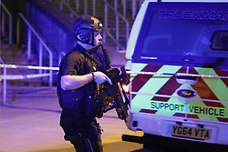 May 22, 2017 - Manchester, England, United Kingdom - Police officers respond to the scene of an explosion near the Manchester Arena during an Ariana Grande concert. Manchester police reported 'a number of confirmed fatalities and others injured' as hundreds of fans fled the arena. (Credit Image: © Joel Goodman/London News Pictures via ZUMA Wire)