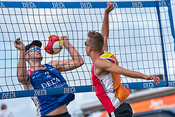Ruben Penninga, Stefan Boermans in action. The Final Day of the DELA NK Beach volleyball for men and women will be played in The Hague Beach Stadium on the beach of Scheveningen on 23 July 2020 in Zaandam.