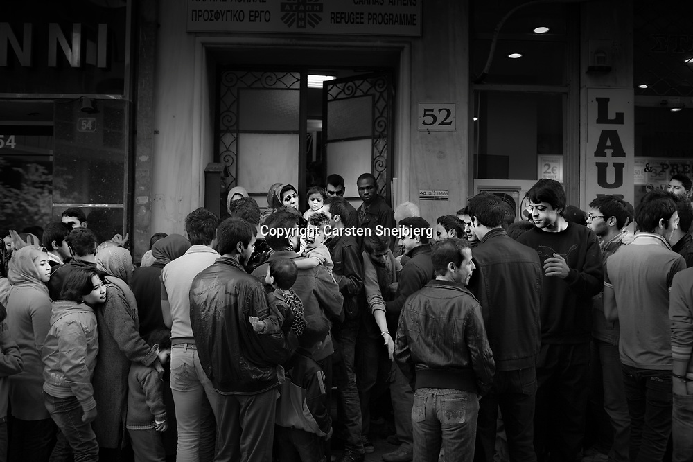 Illegal immigrants are gathered in front of Caritas Refugee Programme in Athens. Caritas distributes warm food every day free of charge to the immigrants. Families get first priority and are allowed access before others. Conflicts and fights erupt between the male immigrants on a daily basis, because they spend hours in line to get food.