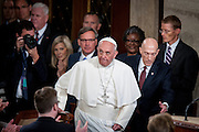 Pope Francis enters the chamber of the House of Representatives as he continues his six-day U.S. tour speaking to a joint meeting of Congress at the U.S. Capitol in Washington, District of Columbia, U.S., on Thursday, Sept. 24, 2015. The Pope is calling for Americans to do more to fight poverty, curb climate change and help immigrants. His visit runs through Sept. 27, and features stops in Washington, New York and Philadelphia. Photographer: Pete Marovich/Bloomberg