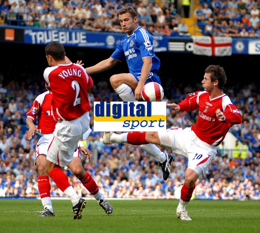 Photo: Ed Godden.<br />Chelsea v Charlton Athletic. The Barclays Premiership. 09/09/2006. Andriy Shevchenko (centre) is challenged by Charlton'S Bryan Hughes (R).
