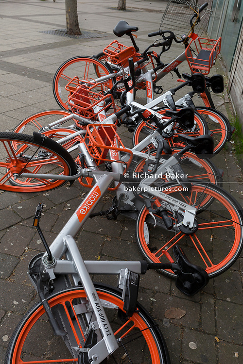 A pile of discarded dockless Mobikes lying on the pavement near Waterloo Station, on 13th March 2019, in London, England.
