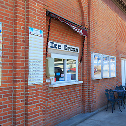 Troy, PA - July 26, 2016: Moose's Munchies serves ice cream through a window in a brick building wall.