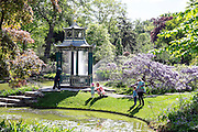 © Licensed to London News Pictures. 13/05/2015. Cliveden, UK. People spot for fish in the Water Garden.  Visitors to the National Trust property Cliveden House enjoy the warm and sunny weather today 13th May 2015. Photo credit : Stephen Simpson/LNP