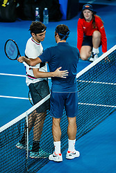 January 19, 2019 - Melbourne, VIC, U.S. - MELBOURNE, VIC - JANUARY 18: TAYLOR HARRY FRITZ (USA) and ROGER FEDERER (SUI) during day five match of the 2019 Australian Open on January 18, 2019 at Melbourne Park Tennis Centre Melbourne, Australia (Photo by Chaz Niell/Icon Sportswire) (Credit Image: © Chaz Niell/Icon SMI via ZUMA Press)