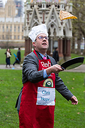 MPs and members of the House of Lords compete in the annual Rehab pancake race, a relay of eleven laps in Victoria Tower Gardens adjacent to the Houses of Parliament in London. The race is held every year on Shrove Tuesday and was won by the Media team. PICTURED: Chris Hope from the Daily Telegraph. London, February 13 2018.
